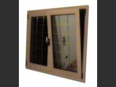 Double-glazed wooden windows with aluminum cover